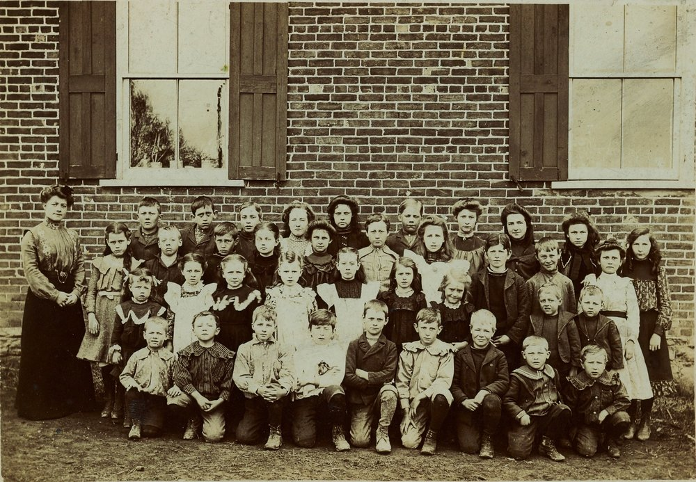 zION SCHOOL 1903  Ella Faulkner -teacher - Clayton Curtis, J. Wright, W.Sharp, Mabel Bailey,  Hazel McMullen,  Clifford Chard, Myrtle Sharp, Elda Janson, Evelyn Eggleton, Flossie Bailey, Martha Pounder, Percy MacMullen, Iva Maybee, Claude Scott,  Selbourne Sharp, Edith Curtis,  Ella Cummings, Vera Sharp,  Meryl Cummings, Liza Sharp, Myrtle MacMullen, Twins Ida and Ila Sharp, Melville and Melbourne Sharpe,  Percy Lawrence, L. Rupert, Serge Johnson, Roy Scott,   B. Sharp, Clifford Maybee,  Floyd Garrison,  Ernst Curtis, Clarence Maybee