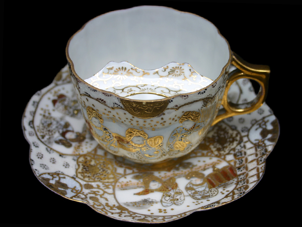 WITH HOT TEA,  wax would melt, and dye would run and gentlemen would get embarrassed,.  SO HARVEY ADAMS,   AN ENGLISH POTTER,  INVENTED THE CUP WITH A MUSTACHE PROTECTOR.