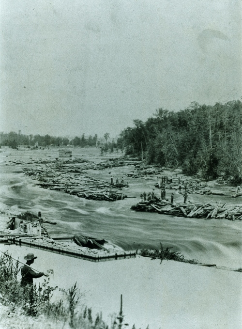 "A Pearce Co lumber drive on the Crowe River.  Marg Monk reported ""Walking boss was Jacques (Jacob) Wilkes, father of Mrs. Garth Sabine."""