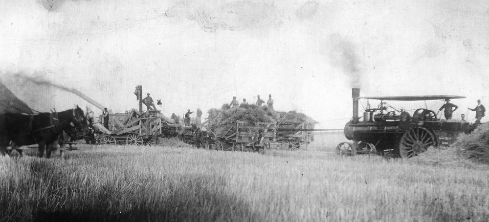 Ted Barrons standing on the threshing machine on left.  He was the brother of George Barrons and moved to Saskatchewan  in 1905.