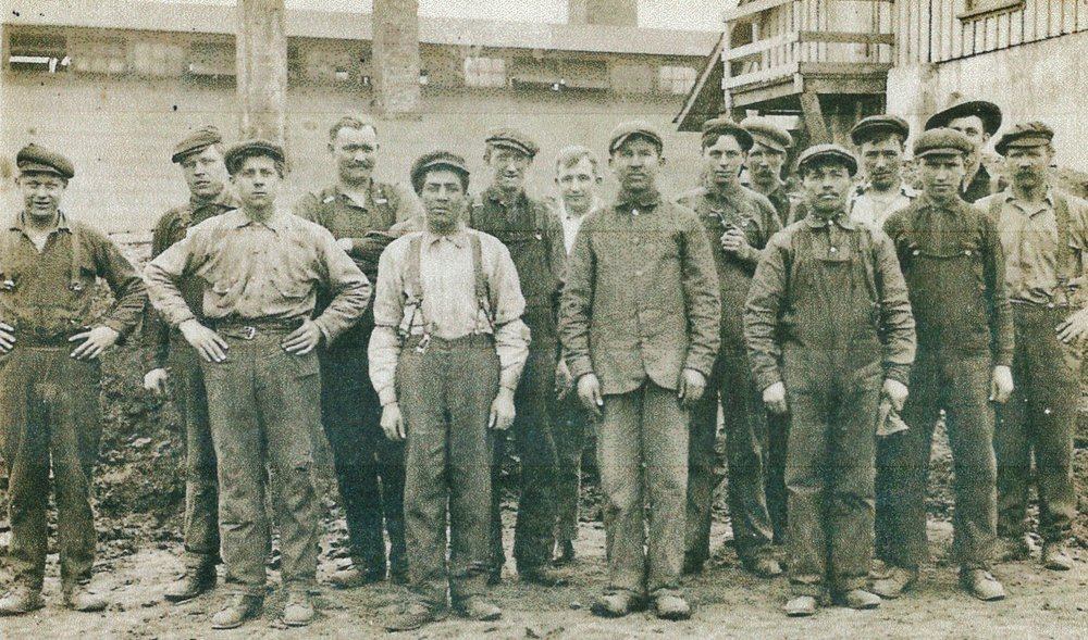 Harry Smith Sr. with workers at Deloro Stellite & Refining Co., circa 1914, together with a picture of  two of Harry Smith's brothers, William and Jack, joining him in Deloro c. 1914 and for a short time worked at Deloro Stellite but eventually William settled on a  farm in Manvers, ON, and Jack settled in Richmond Hill, ON.  Harry Smith, Sr., wearing white shirt with braces.