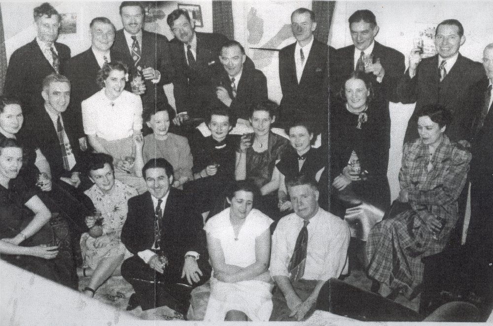 George Brook, Daisy Brooks celebrate their  25th Anniversary with friends and co-workers - top row - L-R Cec Holland, Bill Brown, Bruce MacKenzie, Joe Gillhooley, Tom Brawley, Steve Glembiski, Harold Dalton, Mike Corrigan, Sam Stevens   Seated;  L-R Gertrude Corrigan,  George Mantle,  Grace Gray,  Ivy Mantle,  Evelyn Gill hooley, Jean Brawley, Nora Brown, Mrs. Dalton,   Front: Helen Holland, Lrraine MacKenzie, Percy Gray,  Daisy Brooks,  George Brooks