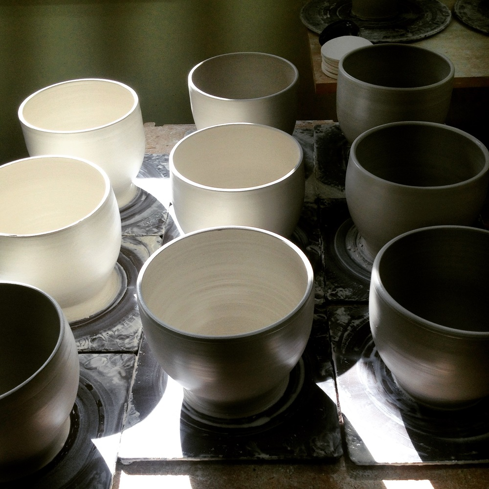 morning light plays off a set of freshly thrown bowls.