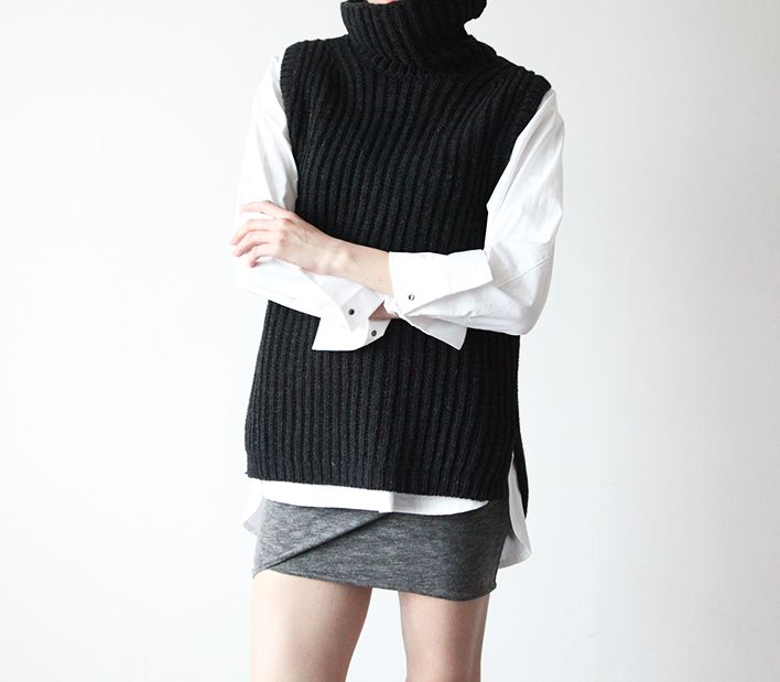 A knit turtleneck with no sleeves.