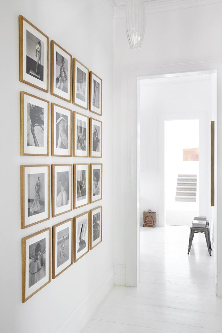 domainehome.com GRID GALLERY- for a more structured look, hang art work in rows and columns. This approach works well with photography.