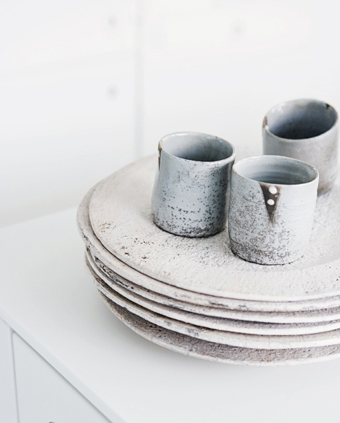 A beautiful set of  ceramic tumblers and plates .