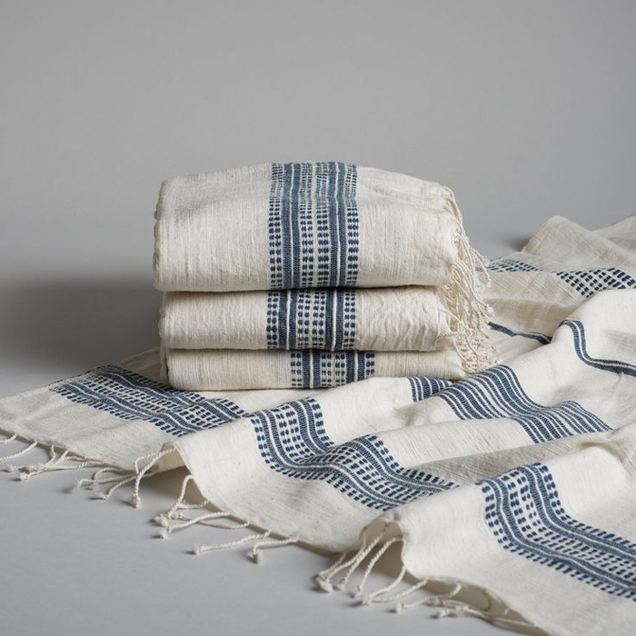 A collection of handmade fair-trade Ethiopian cotton bath sheets.