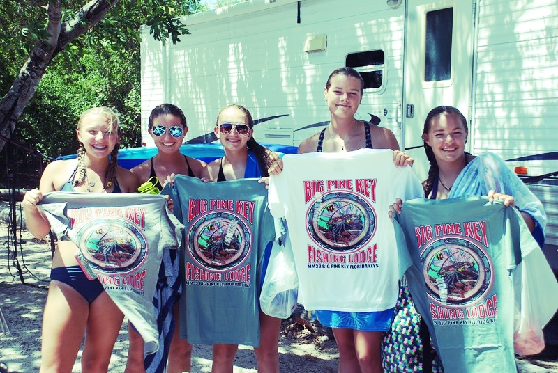 "The brave, wise ""TeePee Women"" commemorate their last year at Coral Reef Week with Big Pine Key Fishing Lodge t-shirts."