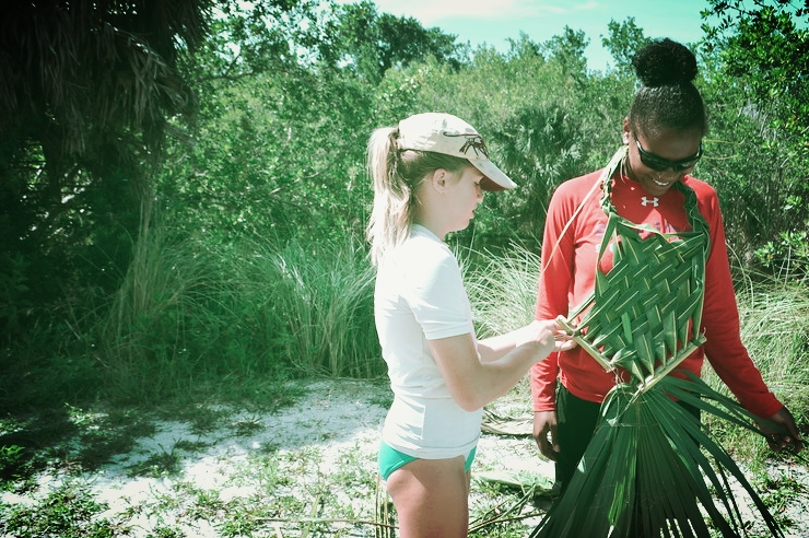Campers get creative with palm materials during the annual Calusa Week Totem Competition.
