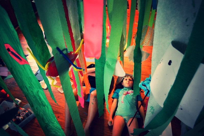 Pippa Valenti admires the giant, upside-down seagrass forest campers created for their parents.