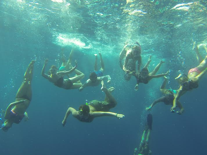 Nicole Finnicum : This is actually the background on my computer. It was the first time I took our teens to Andros Island in the Bahamas. We were trying to snap a photo while swimming in the Tongue of the Ocean, which is 6,000 feet deep. This trip was so memorable to me because I got to see lifelong SX3 campers fall deeply in love with the ocean in the place that I truly fell in love with the ocean - it was such a transformative experience for them and I was so happy to share the moment.