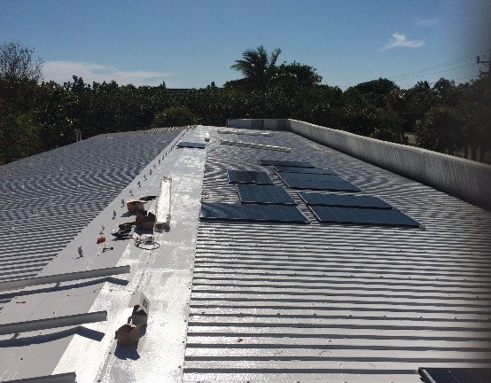 The beginning stages of solar panel installation at Sanibel Sea School's Flagship Campus.