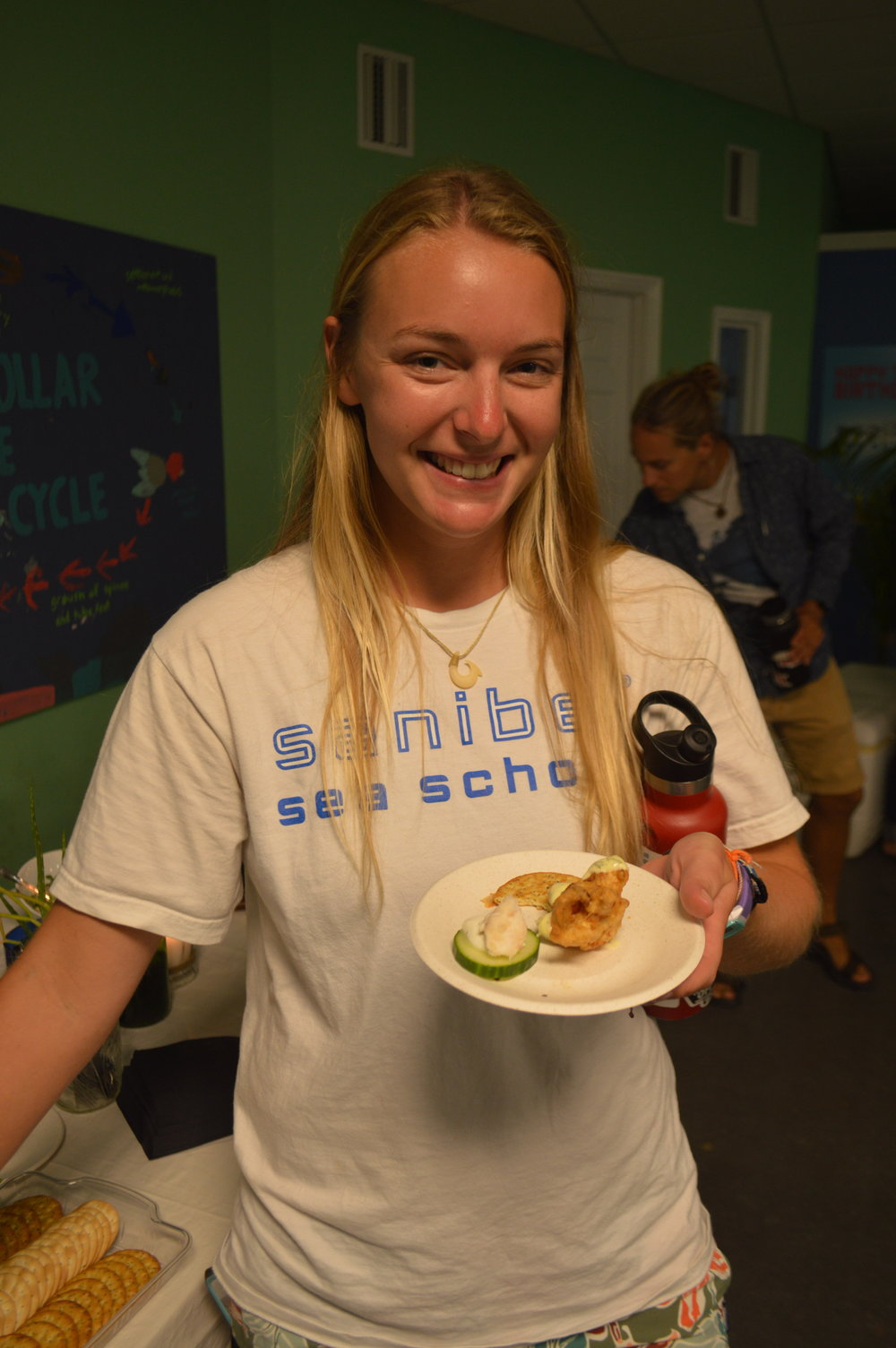 Angel Seery, a marine educator at Sanibel Sea School, enjoyed the food.