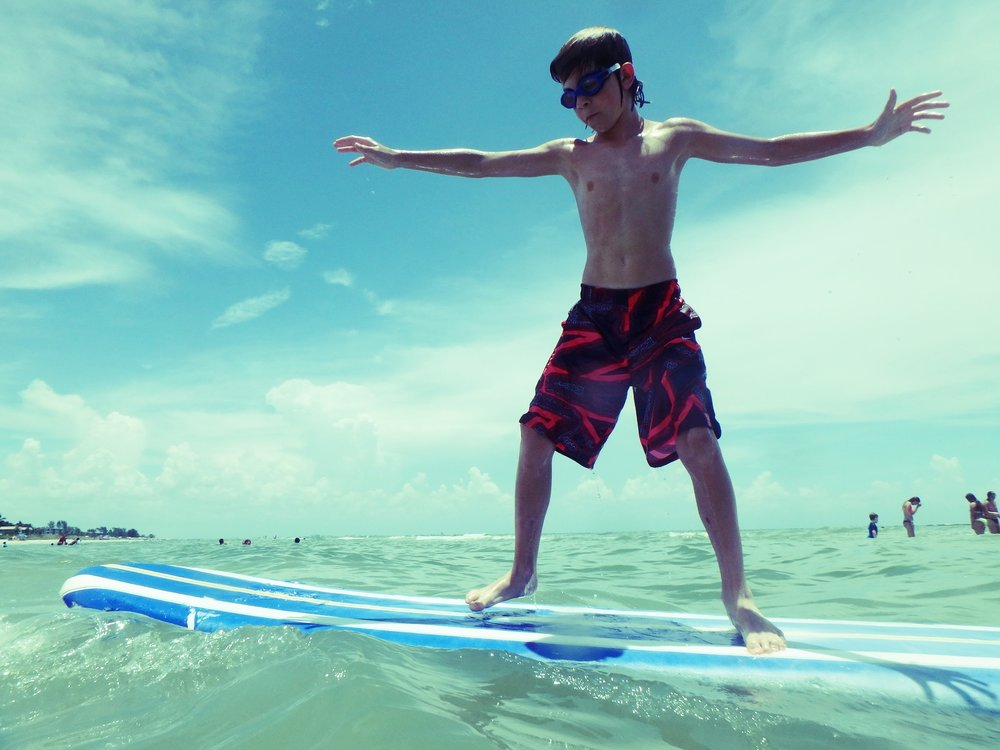 A camper practices surfing.