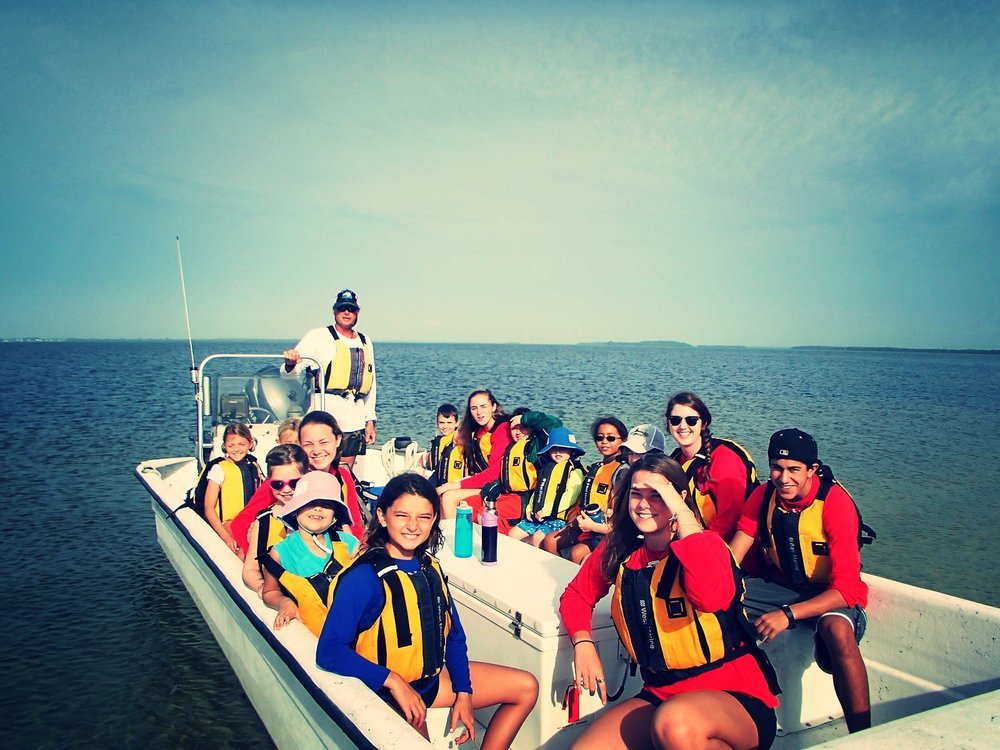 Winter Camp 2016 participants prepare to perform their ocean carols along the Sanibel canals.
