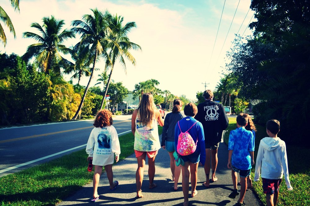 "Campers walk to the beach during Sanibel Sea School's annual ""Give Your Troubles to the Sea"" ceremony."