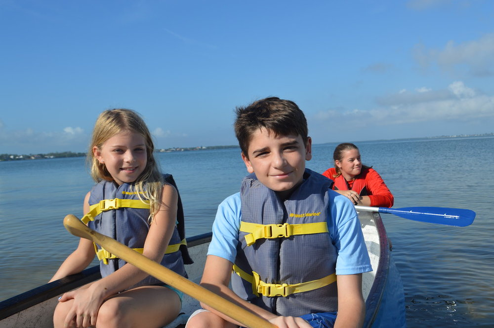 Campers paddled out to perform chants and songs for Sanibel's sharks.