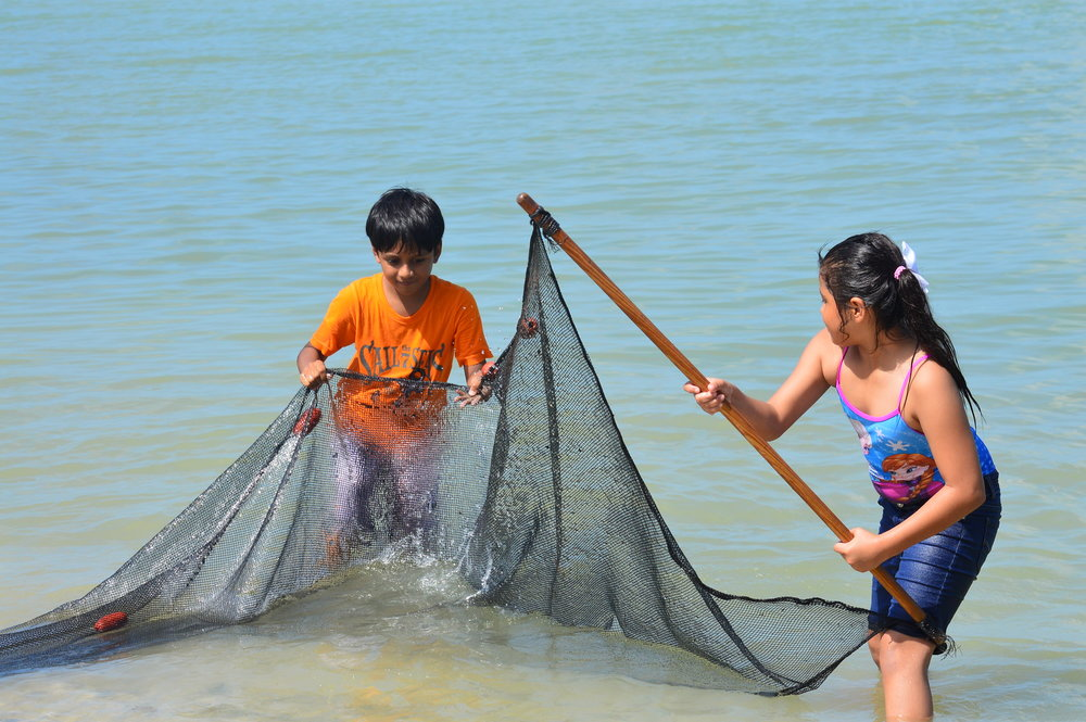 Students from Orangewood Elementary practiced using a seine net at Sanibel Sea School.