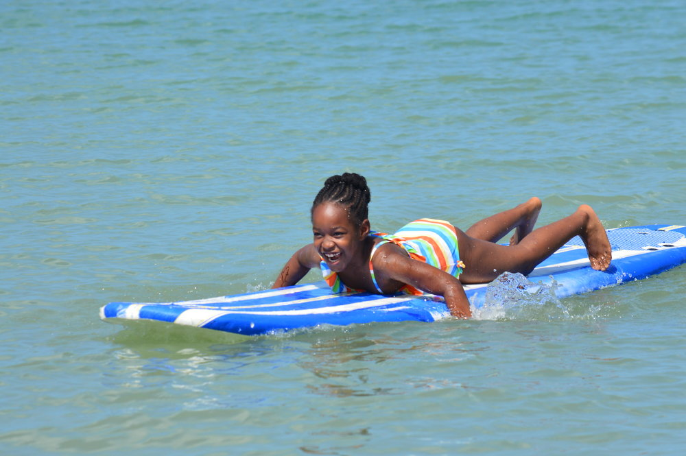 Surfing always brings a smile to students' faces.