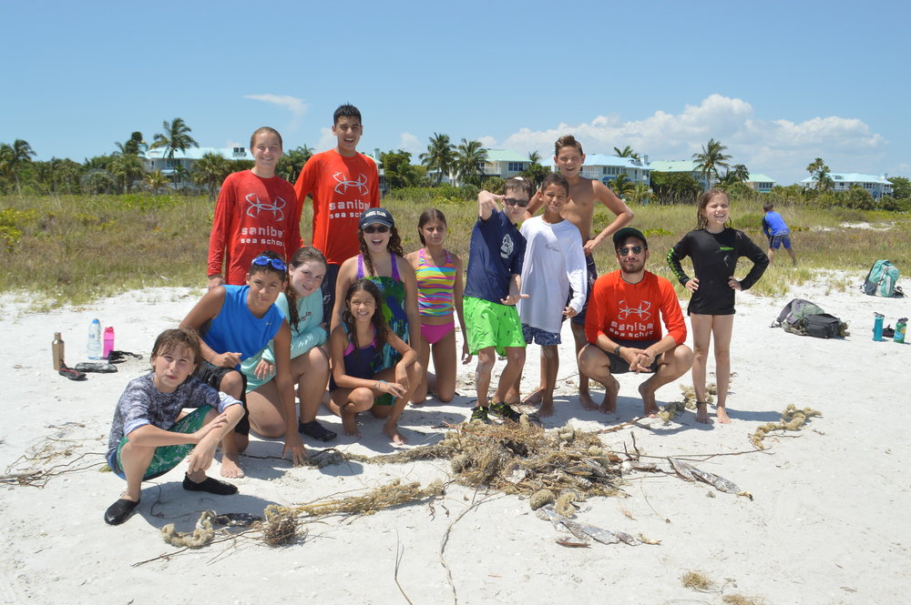 Campers show off their to-scale sand sculpture of a 12-foot Japanese spider crab.