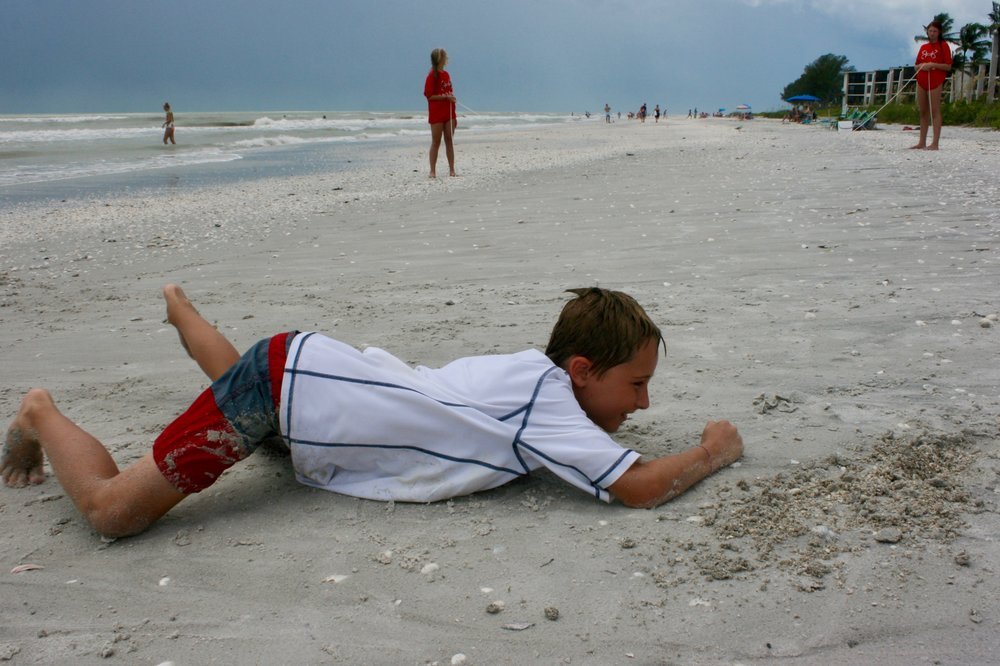 Campers crawled through an obstacle course like sea turtle hatchlings on their way to the sea.