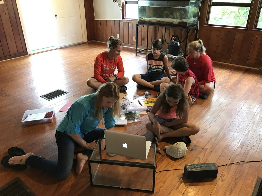 Sanibel Sea School educators Nicole Finnicum, Johnny Rader, and Shannon Stainken, along with students Ben and Jonah Froelich and Addison Sprecher, prepared to Skype with students in Ohio.