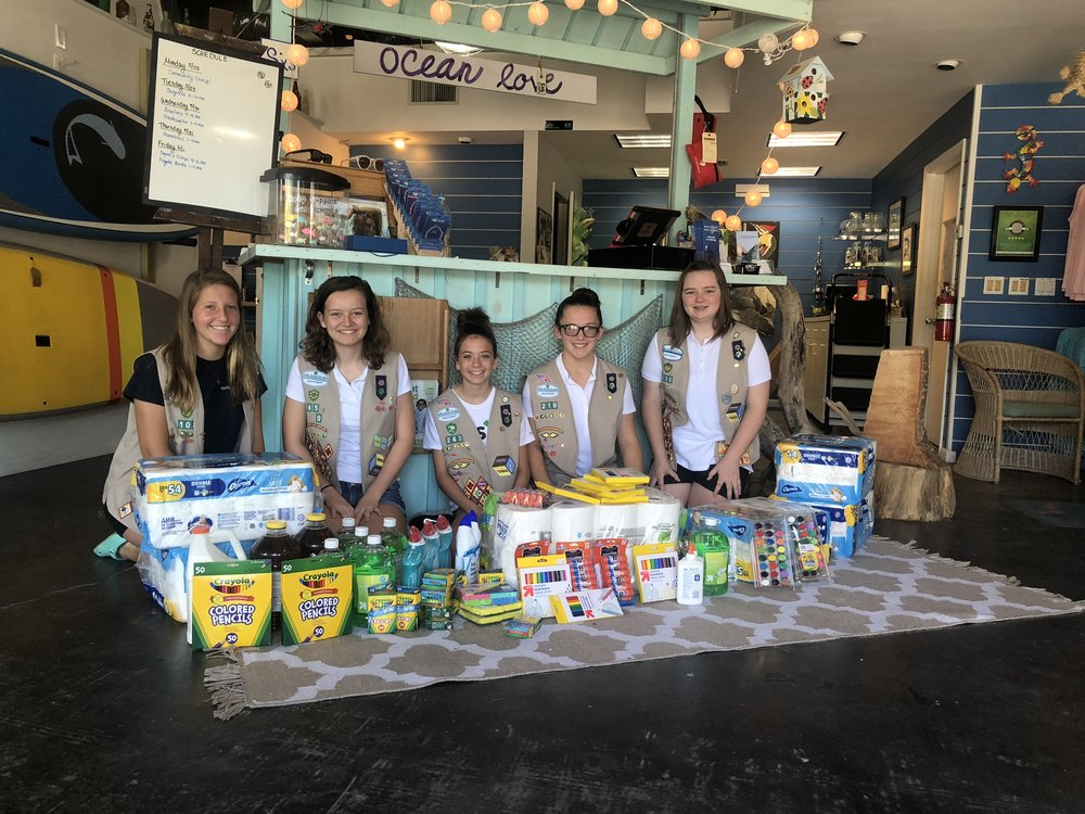 Girl Scout Troop 210 members Courtney Dingerson, Delaney Blackwell, Mia Sedorchuk, Isabella Lauzon, and Zoe Sedorchuk delivered a donation of supplies to Sanibel Sea School.