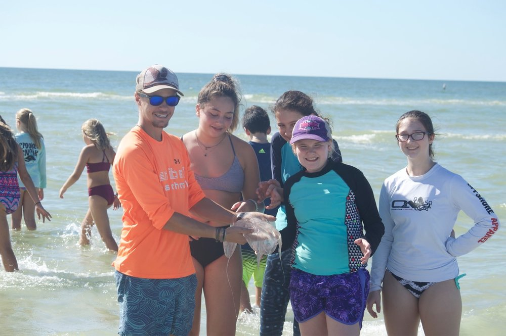 Community camp participants posed for a photo with a moon jellyfish.
