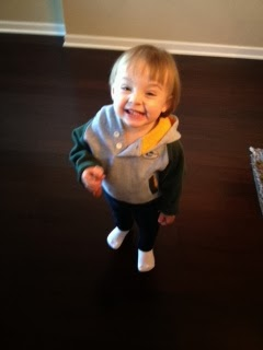 Bee with her little cheese face while sporting her Packers hoodie.