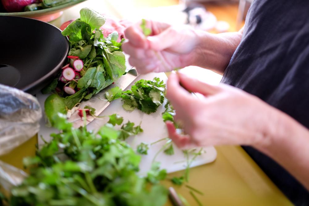 cc EMM hands prepping cilantro radish (1 of 1).jpg