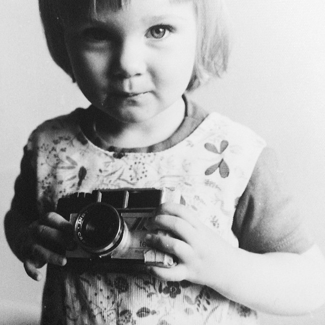 """#fbf to that time at 3yrs old I watched my dad tape up a camera after he showed me how to load the film then he gave it to me saying it was mine and I said """"Really? Just for me?"""" Haha. I think I was drooling a bit too haha there is a series of shots from this moment. I am so lucky to have had it captured. If only I had the pictures from my first camera that I took!!!  #makeportraits #flashbackfriday #bw #childhood #firstcamera @rodneykiwi"""