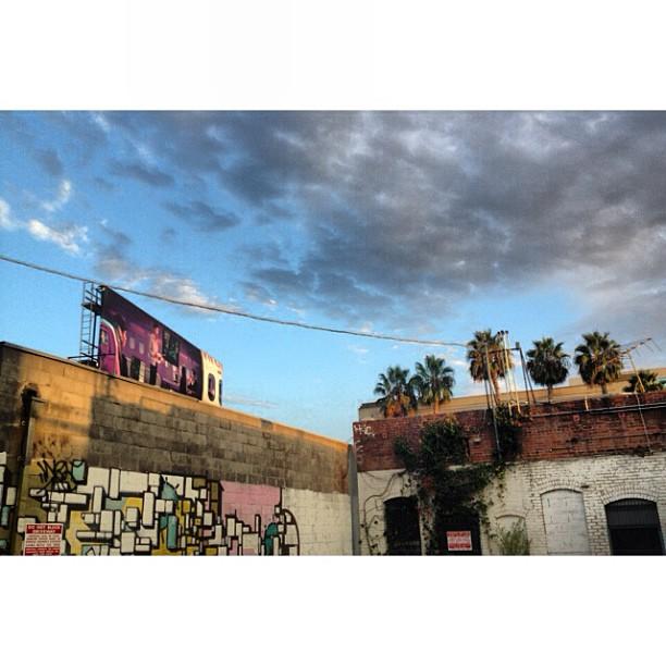 Love courtyards behind brick buildings. #losangeles #beforesunset #skyporn #walkabout #murals #streetart #love