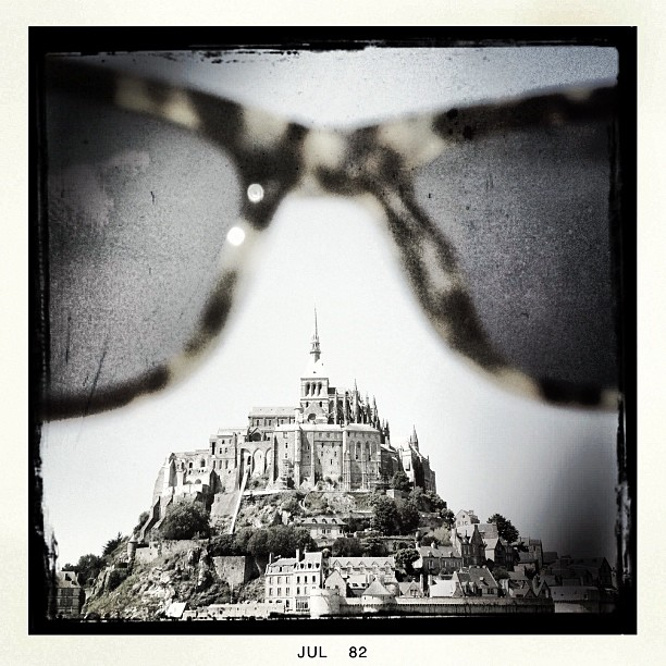 Driving from northern #france to #brussels today. We past #montstmichel  and I had to capture it #throughtheeyes of my @raen_optics can't help it! Haha  (Taken with  Instagram )
