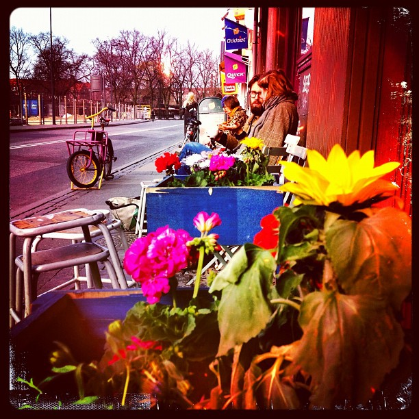 Morning #latte #view #copenhagen I honestly wasn't taking their picture. Even though they are dressed so well and look so hipster. It was all about the flowers for me but he's still giving me the beady eye, lol (Taken with  instagram )
