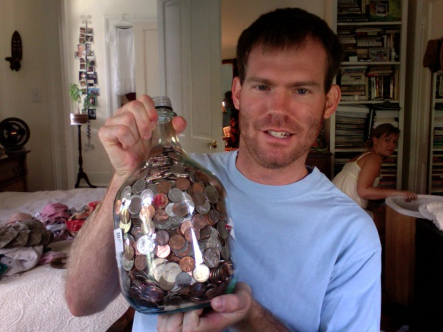 comealive: Time to take in this big jug o' change. Hopefully, this will help pay for our trip to New England. Anyone have a guess for how much it will be? My darling husband caught me sorting laundry in my pajamas… How much do you think we'll get?  My mom says $160.  We've been using this for change since we got married.  I'm pretty sure the jug was sangria that our friend Brett brought over for a Monday Night Dinner.