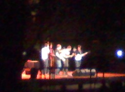 This overly blurry cell-phone picture is of the Punch Brothers playing a Spoleto show at the College of Charleston cistern.   We (Michael, Rita, Leven, Alyse, Matthew, and I) watched from the other side of the iron fence, pushing Spanish moss out of our view and slapping no-see-ums.  But it was FREE while the people on the other side of the gate paid $40.   It was a great concert, and fun spontenanity with people I love.