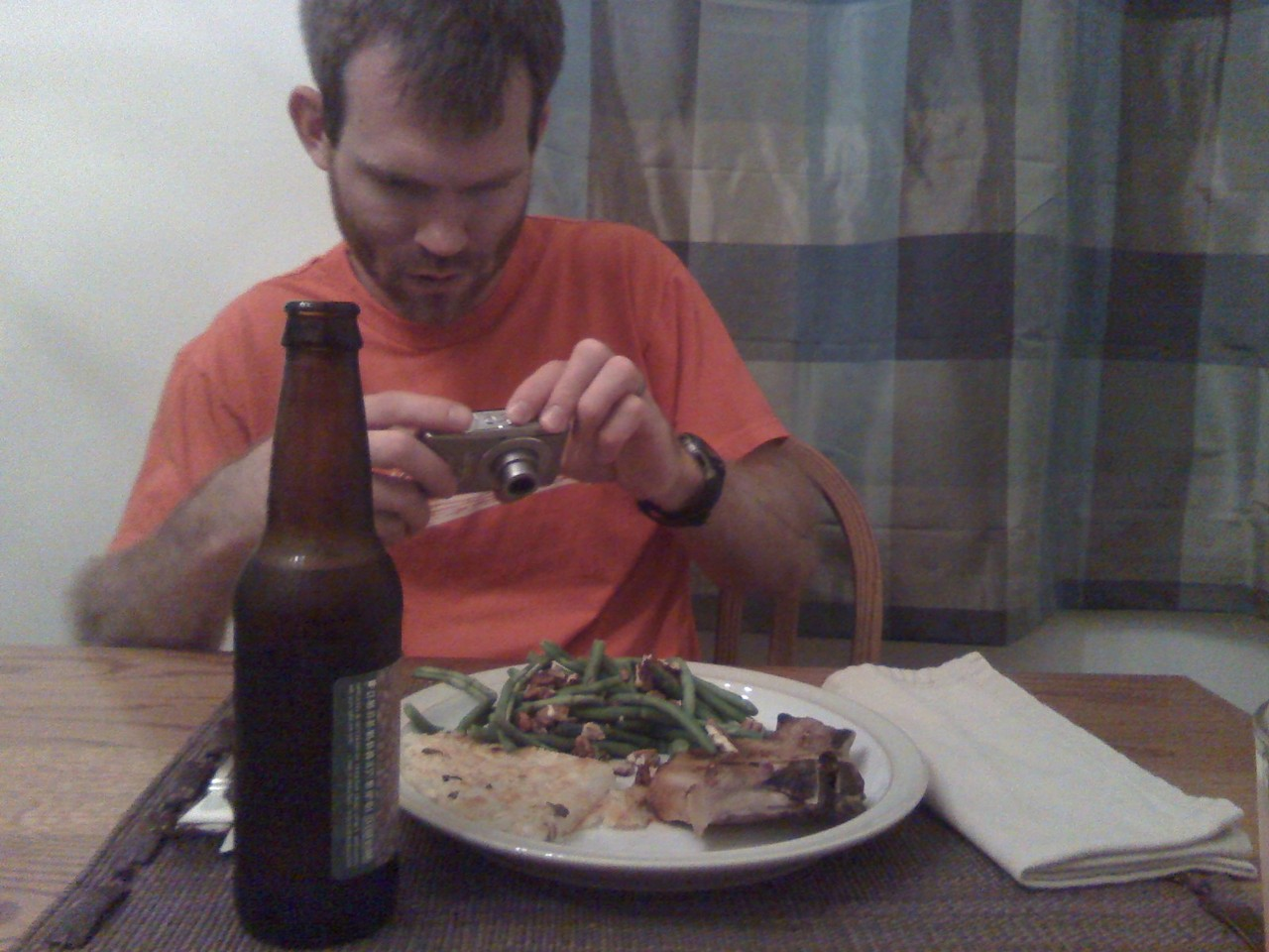 Dinner menu: glazed pork chop, potato pancake, greenbeans with toasted pecans.   Matthew takes a picture of his dinner almost nightly.   Here's the usual before dinner scene.