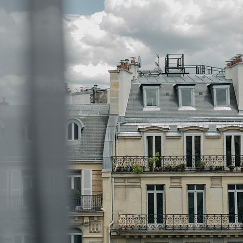 Woke up from a dream of Paris in June. Windows open, drapes dancing.