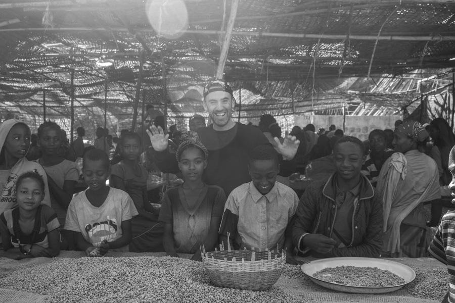 Mark Hiriart with the kids at Aricha Washing Station