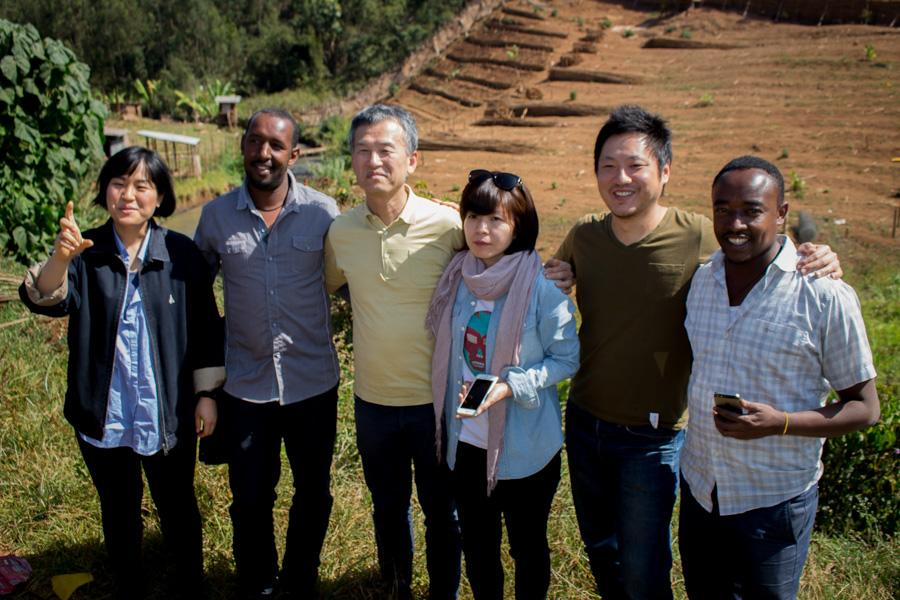 Korean crew with owner of Konga washing station
