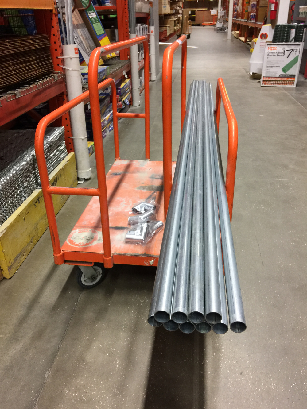 "Shopping for pipe at Home Depot. Decided to go with the top rail for chain-link fences, which is 1-1/4"" galvanized (this is what Dan Gaye of Studio75 used, in the Scott Kelby post)."