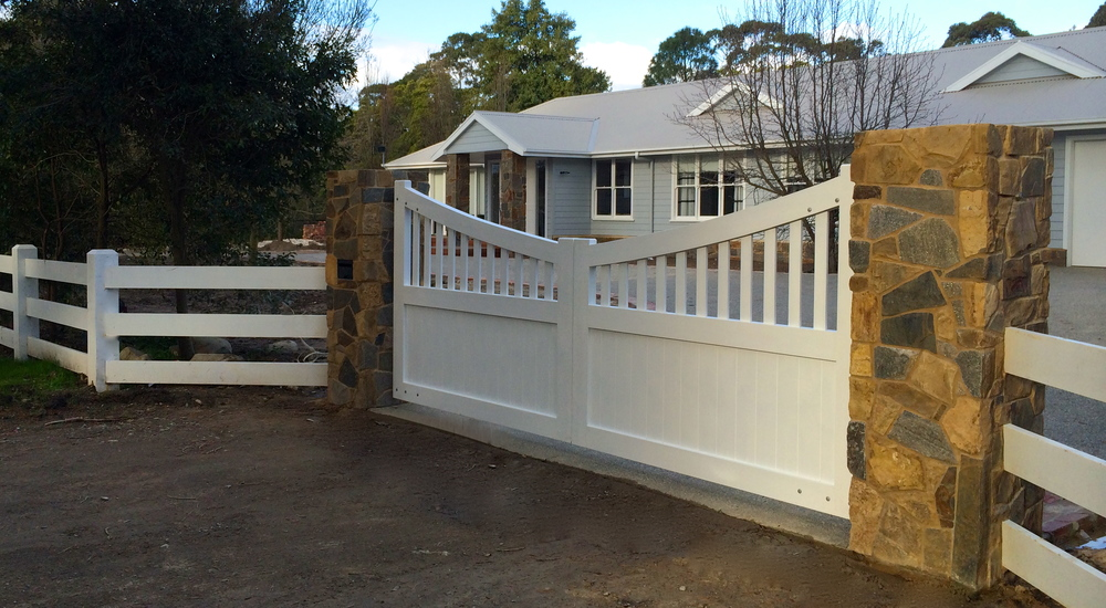 Newly installed gates along with the new pillars and fence, enhancing his property. Brad was so impressed with the transformation he placed an order for a pair of front doors too.