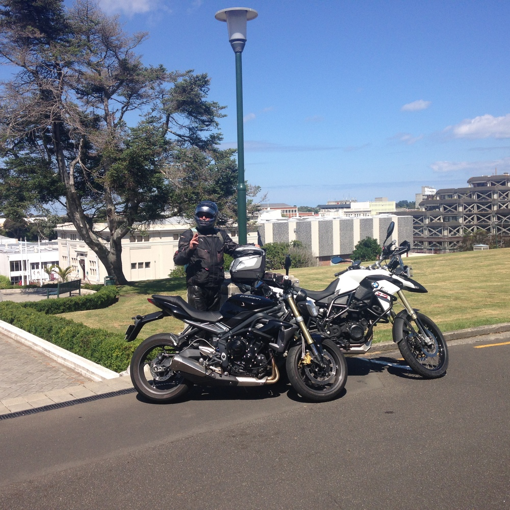 Da with his new baby; the white BMW GS and my lovely Triumph Street Triple-- ahh family shot lol