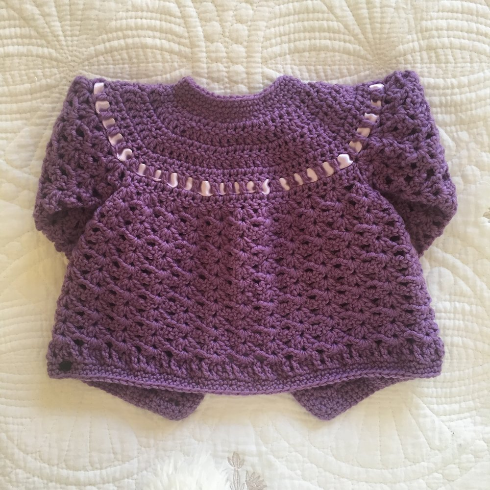 (above) - 'Minxy Matinee', Purple NZ merino, 0-3 months.
