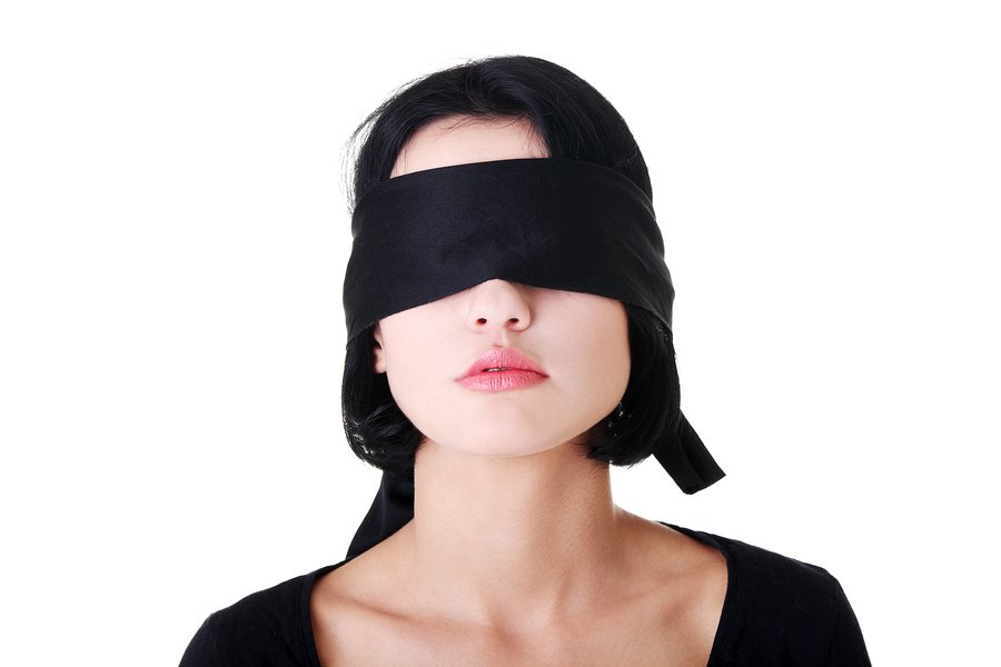 portrait-of-a-young-woman-blindfolded.jpg