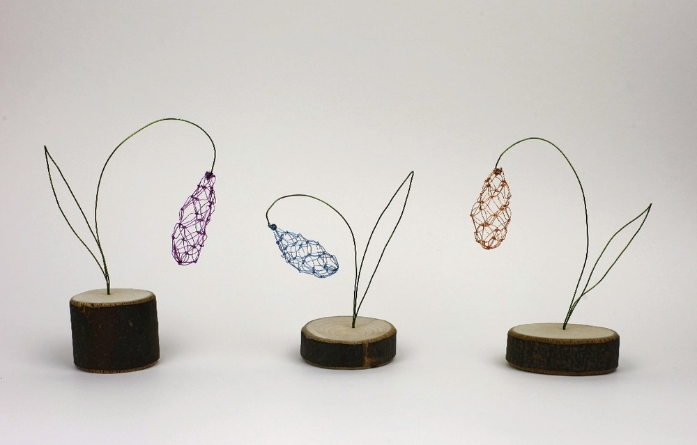 Snowdrops  copper wire on wooden plinths