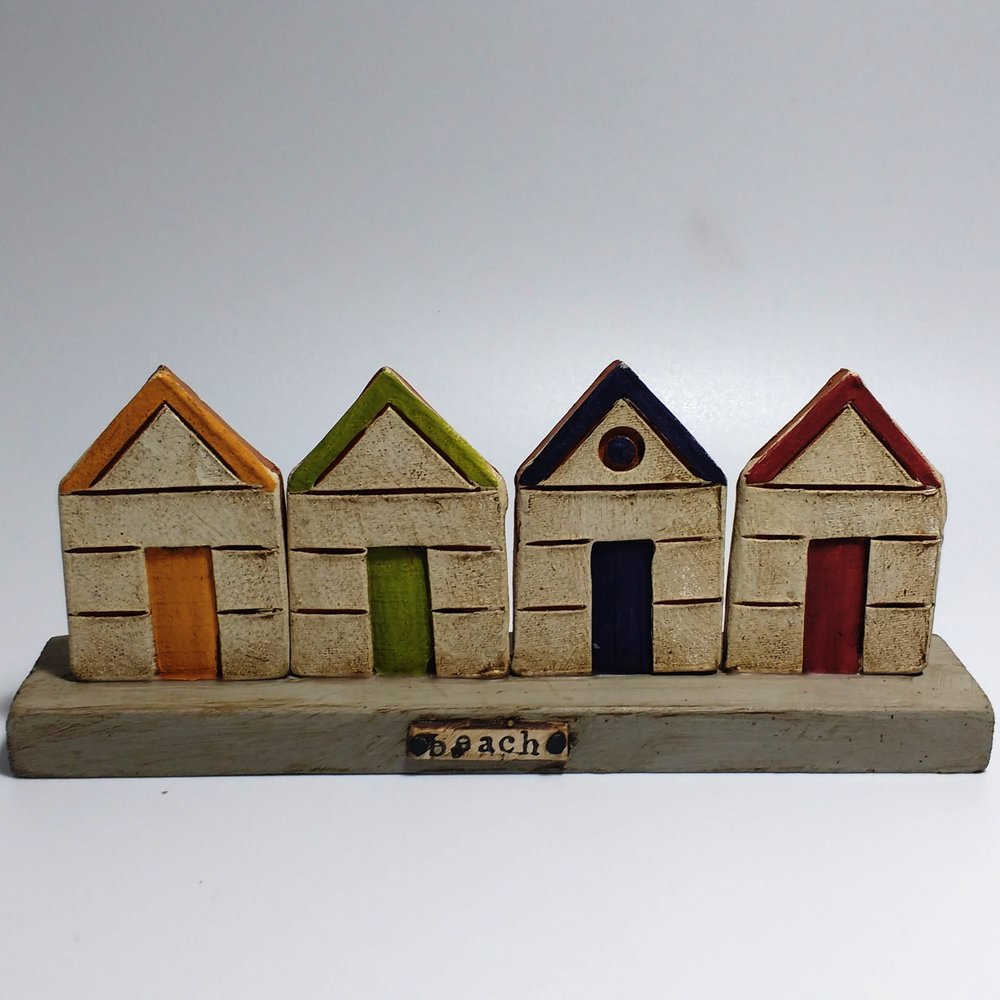 4 Beach Huts  Ceramic on Wooden Plinth  £40