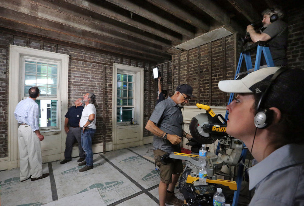"Owner Scott Edwards (left) prepares to film a scene for ""This Old House"" with the show's general contractor Tom Silva (middle) and Mark Regalbuto (in white) of Renew Urban on Wednesday, May 24, 2017. Brad Nettles/Staff.  Brad Nettles bnettles@postandcourier.com"