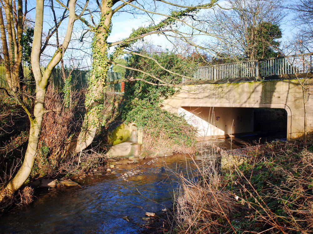 Longton Brook runs through Trentham, which connects the Trent and Mersey Canal with the River Trent. Under this bridge was a popular hiding place during a game of 'Man Hunt' which was essentially hide and seek with extra rules.