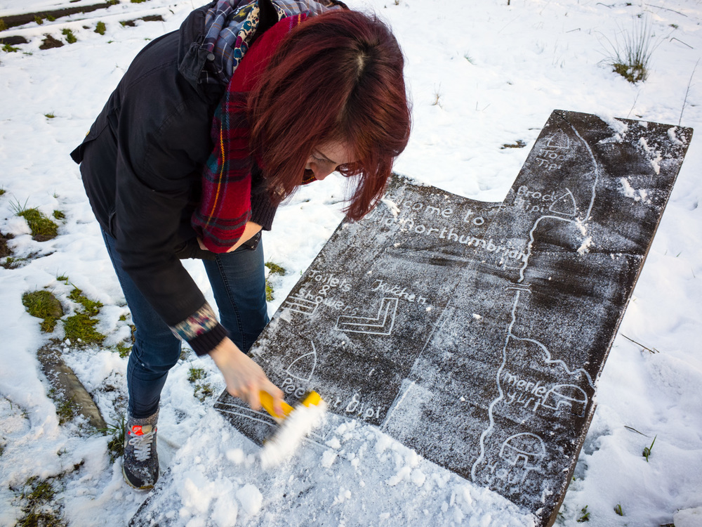 Scraping snow and ice off the site map to find out where our accommodation was.